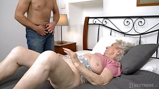 Calumnious granny Norma B spreads her legs for her younger lover